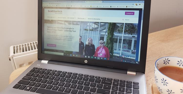 Laptop showing HWWS homepage