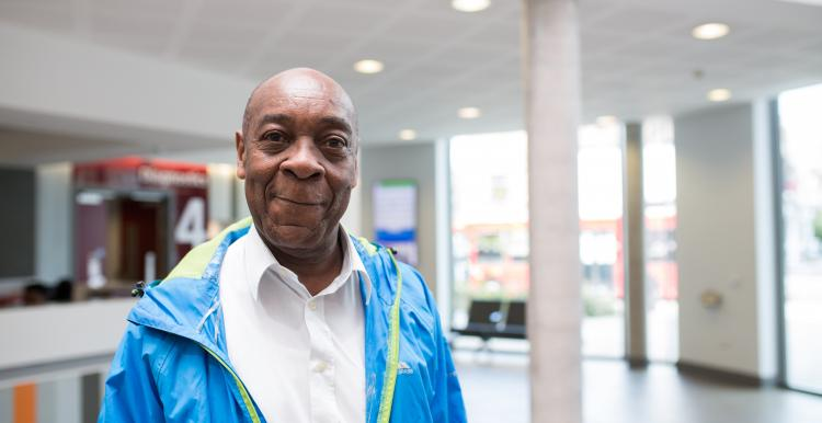 Man standing in a hospital smiling