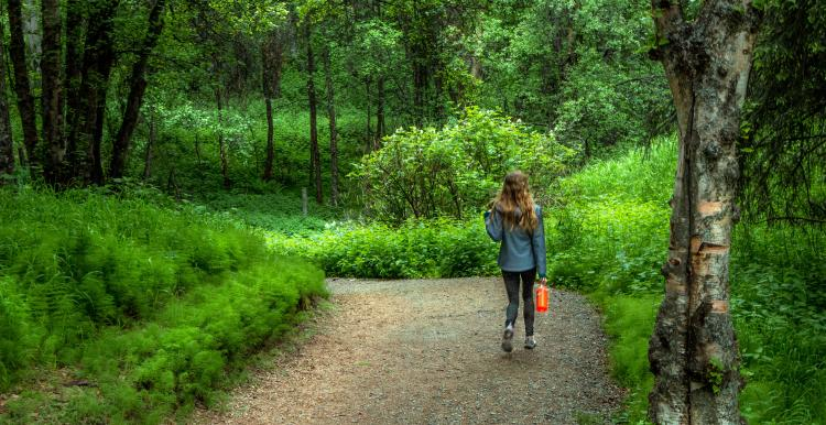 Girl walking in the woods