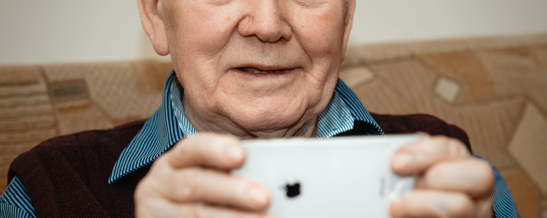 Older man looking at phone