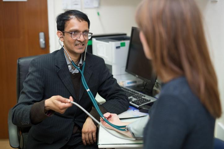 GP staff member with patient