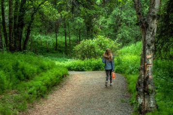 Girl walking in the woods
