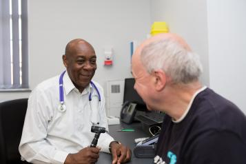 Doctor with patient in GP