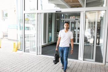 Man walking out of hospital