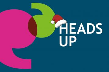Heads Up newspaper logo with Santa hat
