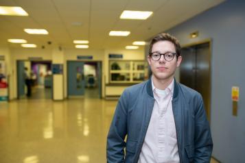 Man standing in hallway