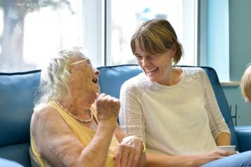 Two ladies talking and laughing