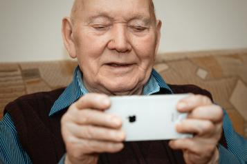 Older man looking at phone