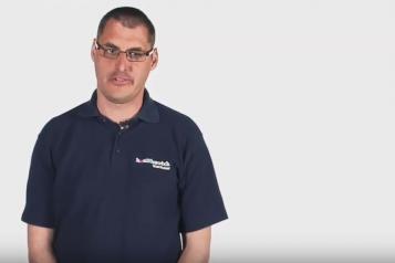 Screen shot of man in video