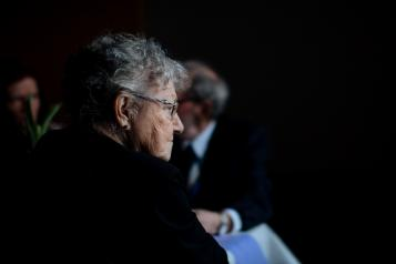 Selective focus photo of older woman with glasses