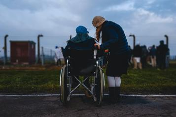 A lady caring for her friend