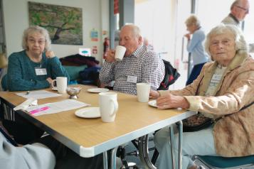 Three people at a memory cafe