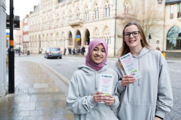 Two young people volunteering with Healthwatch.