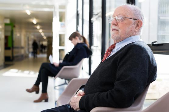 Man sitting in chair waiting for appointment