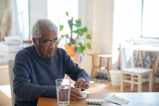 Man sitting at a table at home