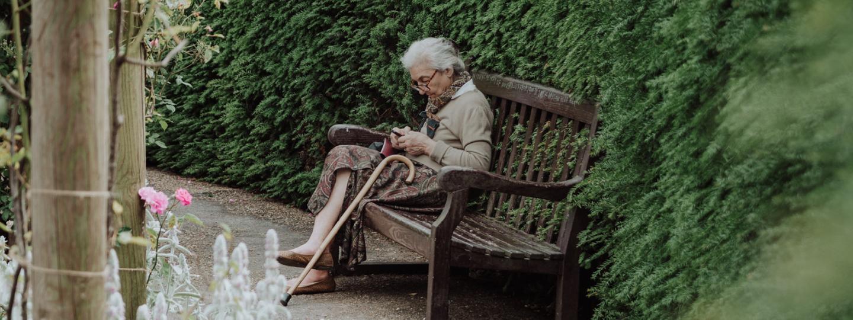 Older lady sitting in garden