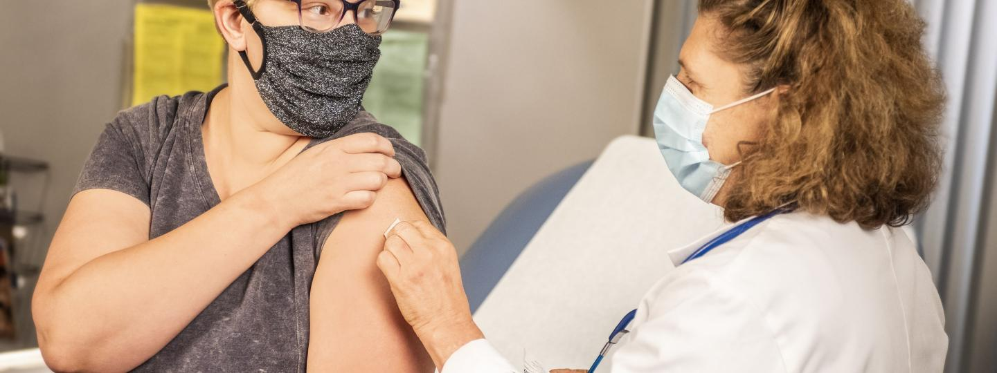 Woman getting her vaccination