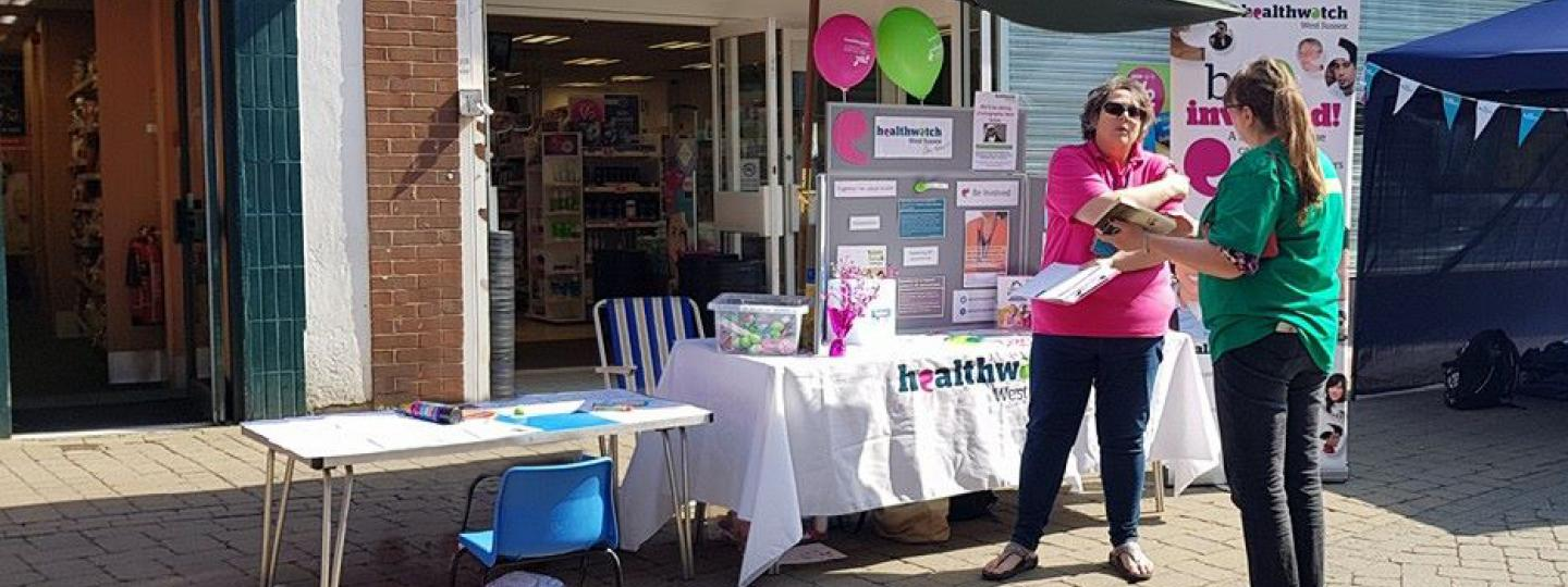 Sophie at stand Healthwatch West Sussex