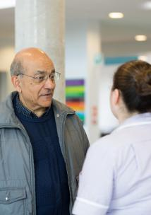 Man in hospital talking to nurse