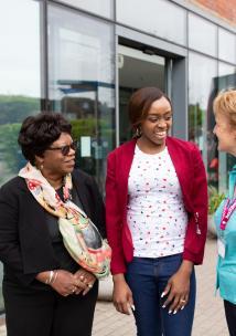 3 ladies talking outside a hospital
