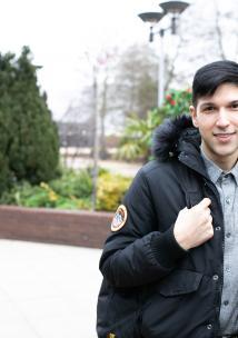 young man smiling at the camera