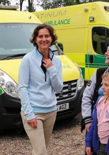 Ladies standing by an ambulance