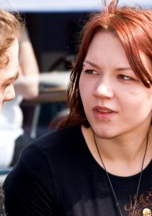 Young woman mid conversation with a young man