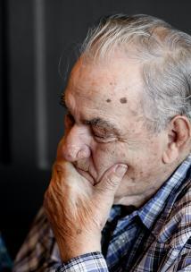An older man looking down